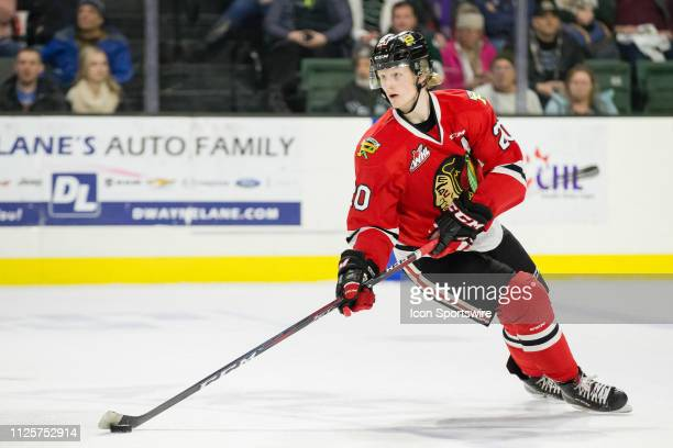 Portland Winterhawks forward Joachim Blichfeld circles back with the puck in the neutral zone during a game between the Everett Silvertips and the...