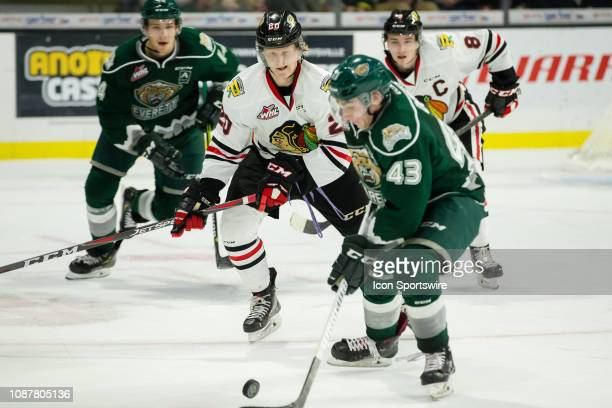 Portland Winterhawks forward Joachim Blichfeld tracks the puck on Everett Silvertips forward Connor Dewar's stick during a game between the Portland...