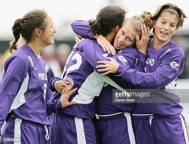 Portland's Christine Sinclair celebrates with teammates Stephanie Lopez Kelsy Hollenbeck and Angie Woznuk after scoring a goal during the 2005 NCAA...
