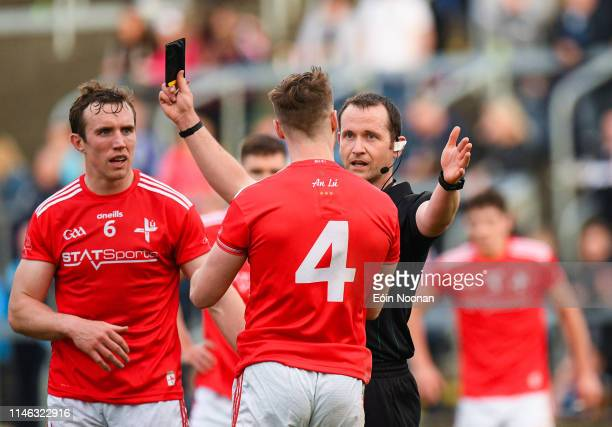 Portlaoise , Ireland - 25 May 2019; James Craven of Louth is shown a black card by referee Jerome Henry during the Leinster GAA Football Senior...