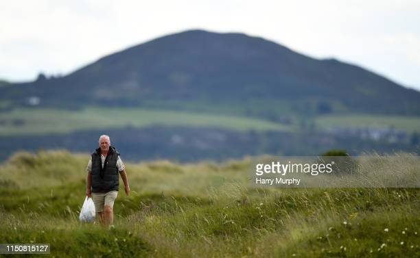 Portmarnock Ireland 19 June 2019 A spectator arrives during day 3 of the RA Amateur Championship at Portmarnock Golf Club in Dublin