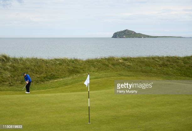 Portmarnock Ireland 19 June 2019 Eanna Griffin of Waterford Golf Club Co Waterford Ireland putts on the 15th green infront of Ireland's Eye during...