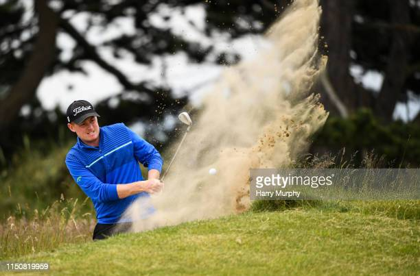Portmarnock Ireland 19 June 2019 Eanna Griffin of Waterford Golf Club Co Waterford Ireland chips from a bunker on the 16th hole during day 3 of the...