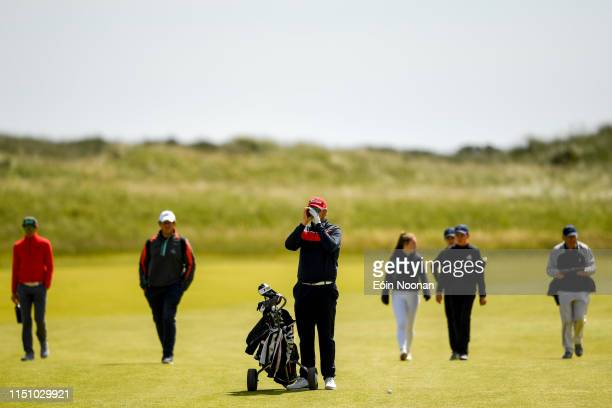 Portmarnock Ireland 20 June 2019 Jonatan Jolkkonen of Finland checks the distance from his ball to the pin on the 13th hole during day 4 of the RA...