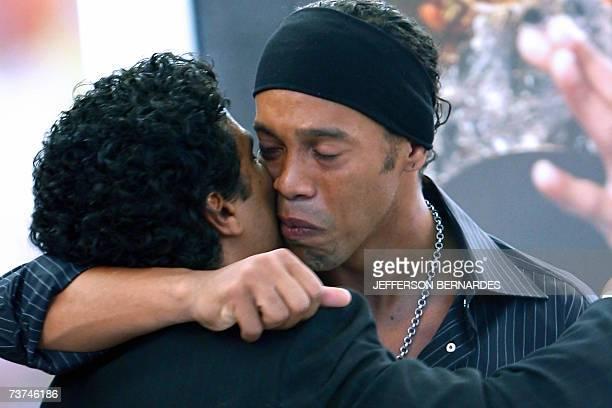 Brazilian football star Ronaldinho Gaucho , player of Spanish Barcelona and member of Brazil's national team cries as he hugs his brother Roberto de...