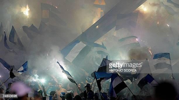 Brazil's Gremio fans cheer their team with fireworks and waving flags before the start of the Libertadores Cup final match with Boca Juniors 20 June...