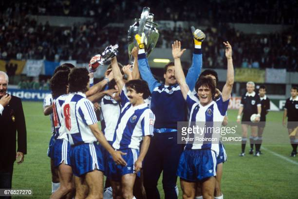 FC Porto captain Joao Pinto lifts aloft the European Cup after his side beat Bayern Munich 21 Also picture are teammates Paulo Futre Rabah Madjer...