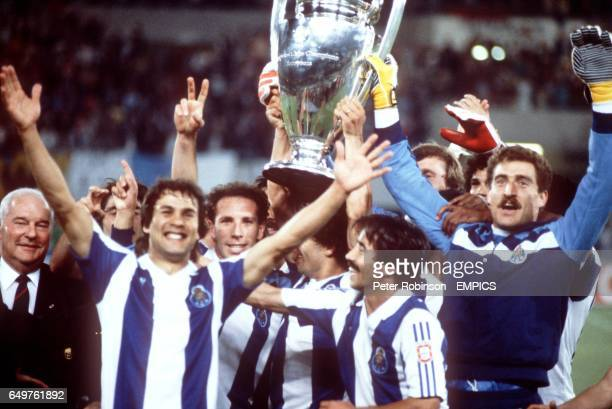 Porto celebrate winning the European Cup for the first time with first goal scorer Rabah Madjer at the front