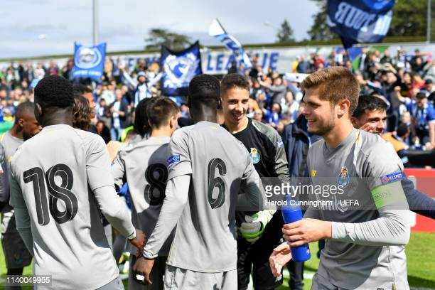 Porto celebrates their victory after the Hoffenheim v Porto UEFA Youth League Semi Final at Colovray Sports Centre on April 26 2019 in Nyon...