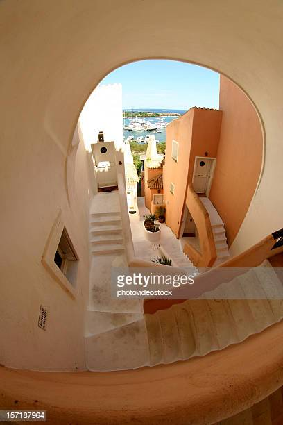 porto cervo stairs and houses - esher stock pictures, royalty-free photos & images