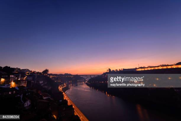 porto city downtown and douro river at sunset - douro river stock photos and pictures