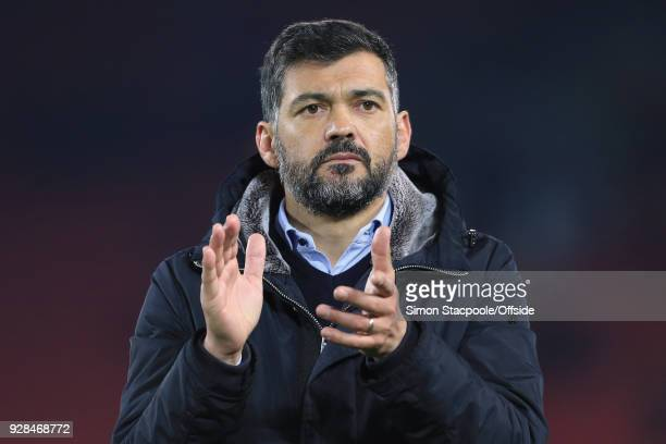 Porto coach Sergio Conceicao applauds the support after the UEFA Champions League Round of 16 Second Leg match between Liverpool and FC Porto at...