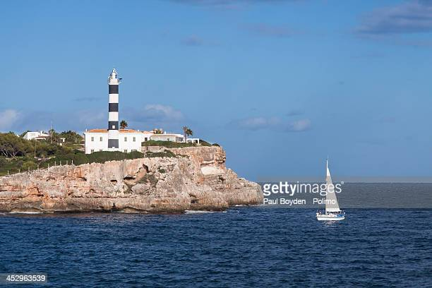 Porto Colom lighthouse with sail boat