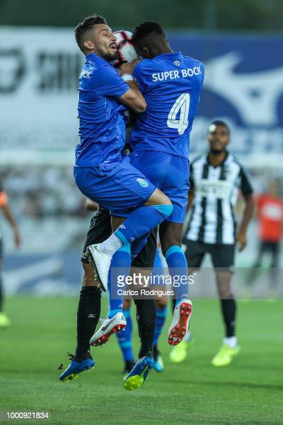 Porto defender Alex Telles from Brazil and FC Porto defender Chidozie Awaziem from Nigeria heads the ball during the Portimonense SC v FC Porto...