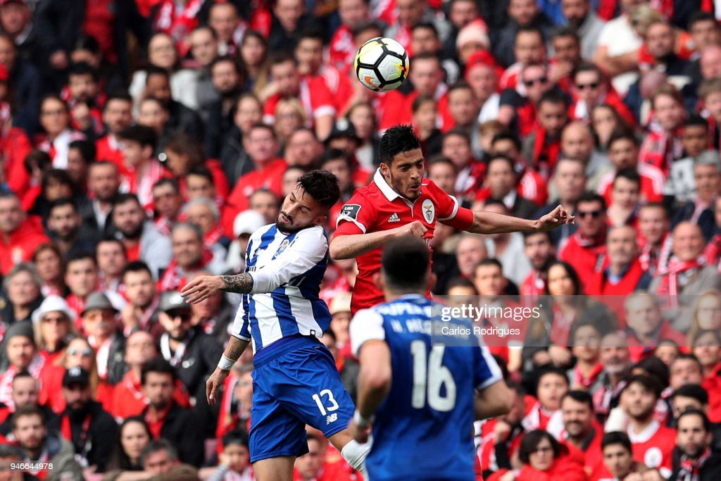 FC Porto defender Alex Telles from Brazil (L) vies with SL Benfica forward Raul Jimenez from Mexico (R) for the ball possession during the Portuguese Primeira Liga match between SL Benfica and FC Porto at Estadio da Luz on April 15, 2018 in Lisbon, Lisboa.
