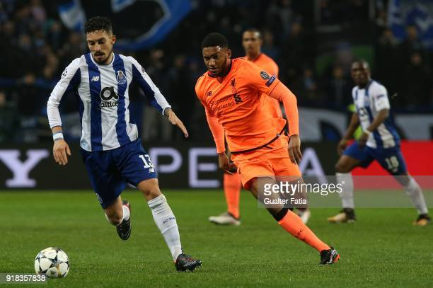 Porto defender Alex Telles from Brazil with Liverpool defender Joe Gomez from England in action during the UEFA Champions League Round of 16 First...