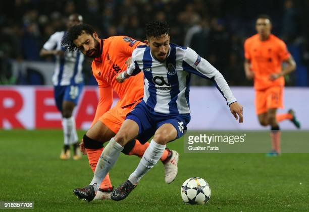Porto defender Alex Telles from Brazil with Liverpool forward Mohamed Salah from Egypt in action during the UEFA Champions League Round of 16 First...