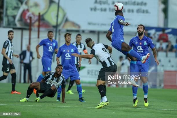 Porto defender Chidozie Awaziem from Nigeria higher heads the ball during the Portimonense SC v FC Porto PreSeason Friendly match at Estadio...
