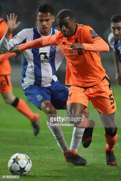 Porto defender Diego Reyes from Mexico vies with Liverpool midfielder Georgina Wijnaldum from Netherland for the ball possession during the UEFA...