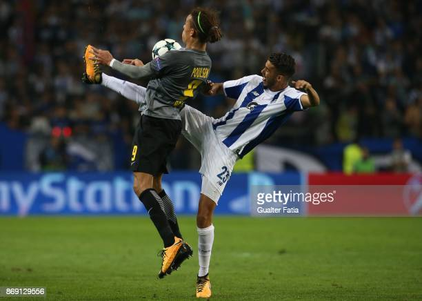 Porto defender Diego Reyes from Mexico with RB Leipzig forward Yurary Poulsen from Denmark in action during the UEFA Champions League match between...