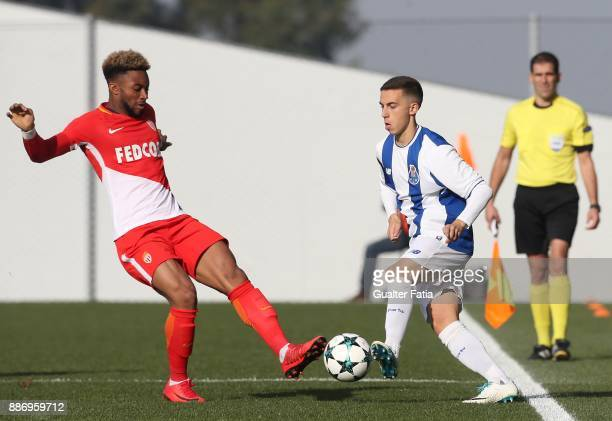 Porto defender Diogo Bessa with Monaco forward Moussa Sylla from France in action during the UEFA Youth League match between FC Porto and AS Monaco...