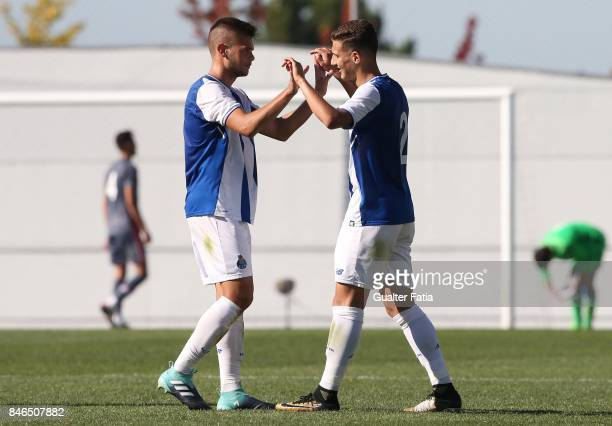 Porto defender Diogo Dalot celebrates their victory with teammate FC Porto defender Diogo Queiros at the end of the UEFA Youth League match between...