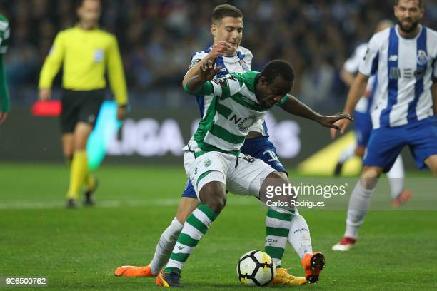 Porto defender Diogo Dalot from Portugal vies with Sporting CP forward Seydou Doumbia from Ivory Coast for the ball possession during the Portuguese...