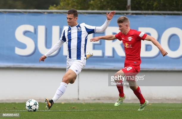 Porto defender Diogo Dalot with RB Leipzig midfielder Lucas Schmidt from Germany in action during the UEFA Youth League match between FC Porto and RB...