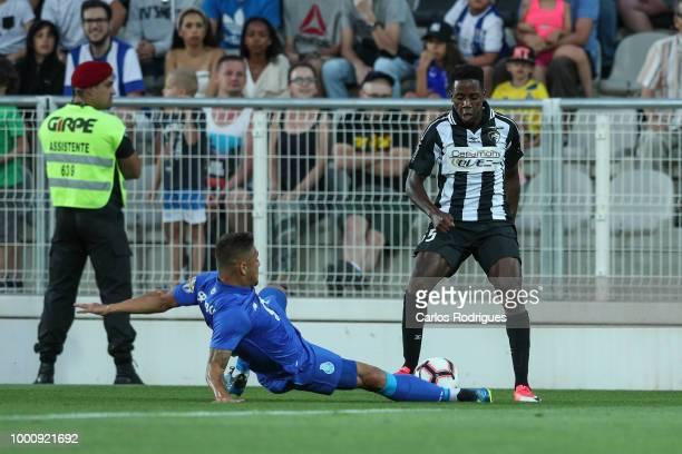 Porto defender Joao Pedro from Brazil vies with Portimonense SC forward Wilson Manafa from Portugal for the ball possession during the Portimonense...