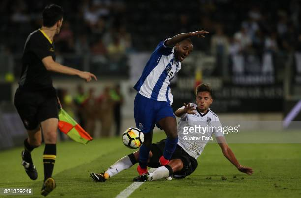 Porto defender Ricardo Pereira from Portugal tackled by Vitoria Guimaraes forward Joao Vigario from Portugal during the PreSeason Friendly match...
