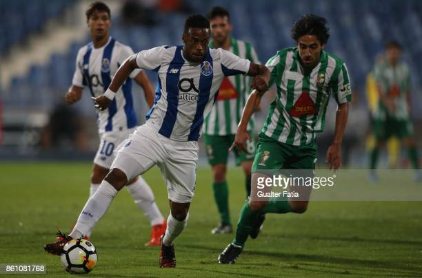 Porto forward Hernani Fortes from Portugal with Lusitano Ginasio Clube defender Joao Nobre from Portugal in action during the Portuguese Cup match...