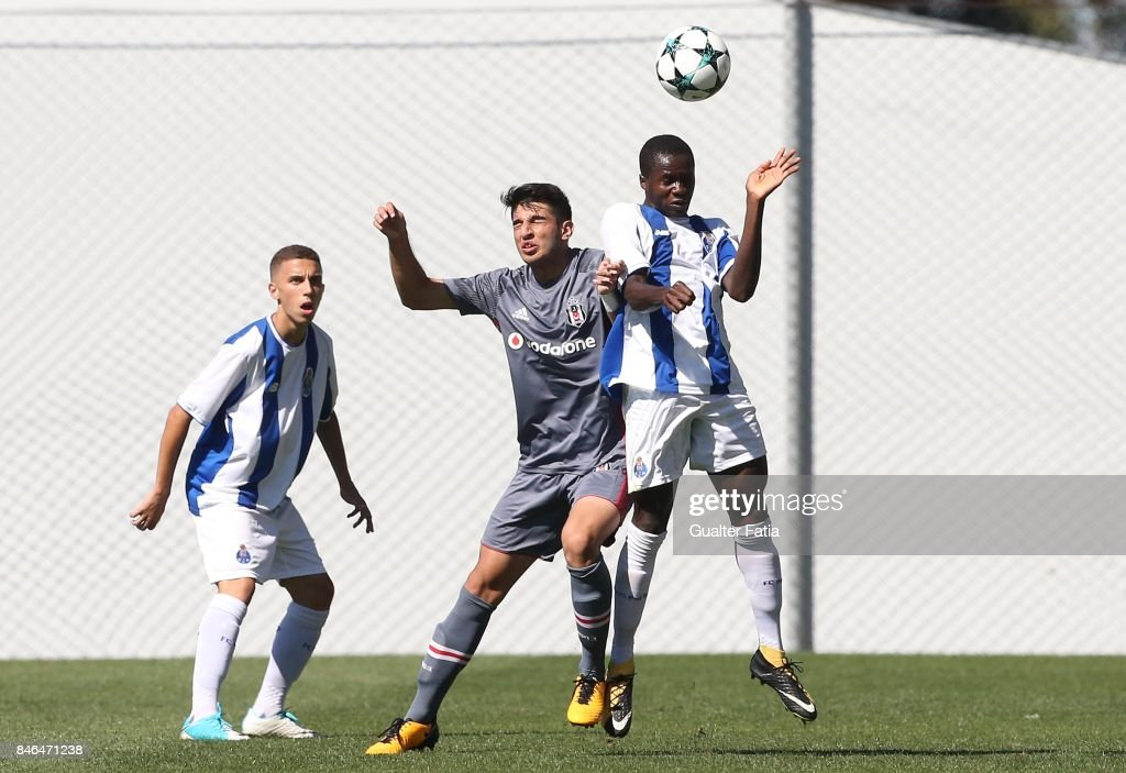 FC Porto forward Madi Queta with Besiktas midfielder Mertcan Acikgoz from Turkey in action during the UEFA Youth League match between FC Porto and Besiktas JK at Centro de Estagios do Olival on September 13, 2017 in Olival, Portugal.