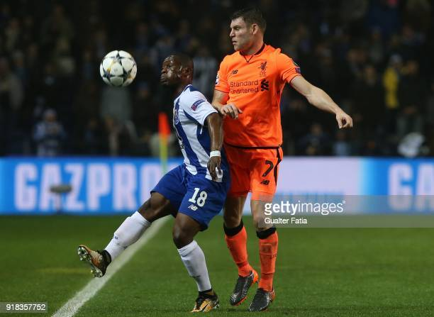 Porto forward Majeed Waris from Ghana with Liverpool midfielder James Milner from England in action during the UEFA Champions League Round of 16...
