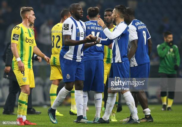 Porto forward Moussa Marega from Mali celebrates with teammate FC Porto defender Alex Telles from Brazil the victory at the end of the Primeira Liga...