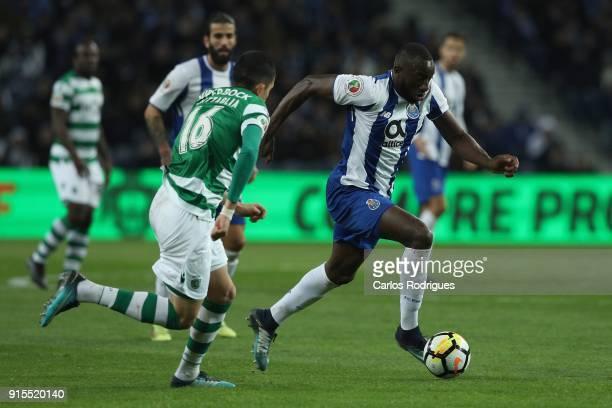 Porto forward Moussa Marega from Mali tries to escape Sporting CP midfielder Rodrigo Battaglia from Argentina during the FC Porto v Sporting CP Taca...