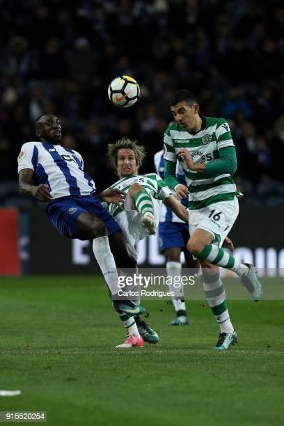 Porto forward Moussa Marega from Mali vies with Sporting CP defender Fabio Coentrao from Portugal and Sporting CP midfielder Rodrigo Battaglia from...