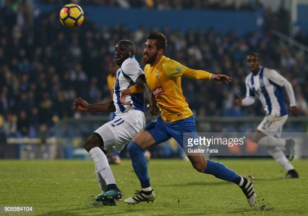 Porto forward Moussa Marega from Mali with GD Estoril Praia midfielder Charis Kyriakou from Cyprus in action during the Primeira Liga match between...
