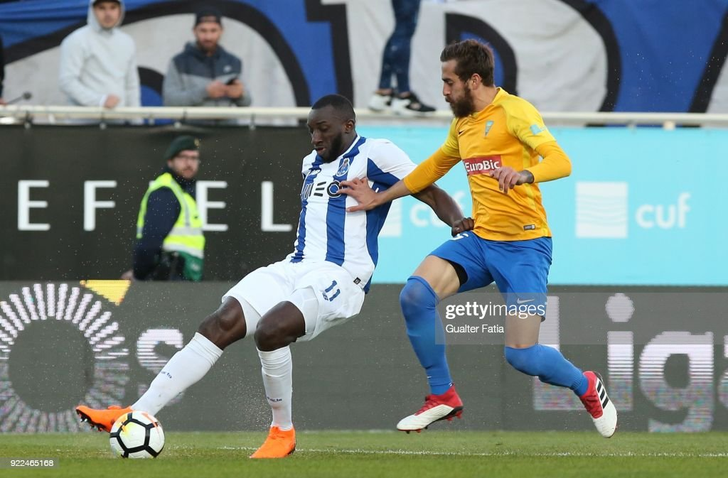 FC Porto forward Moussa Marega from Mali with GD Estoril Praia midfielder Charis Kyriakou from Cyprus in action during the Primeira Liga match between GD Estoril Praia and FC Porto at Estadio Antonio Coimbra da Mota on February 21, 2018 in Estoril, Portugal.
