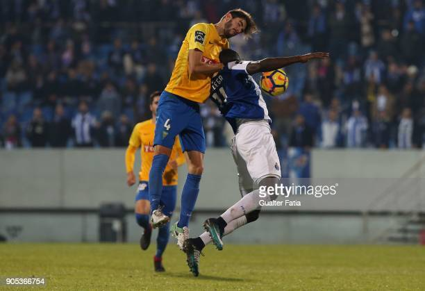 Porto forward Moussa Marega from Mali with GD Estoril Praia defender Pedro Monteiro from Portugal in action during the Primeira Liga match between GD...