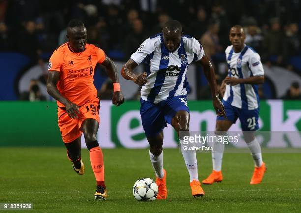 Porto forward Moussa Marega from Mali with Liverpool forward Sadio Mane from Senegal in action during the UEFA Champions League Round of 16 First Leg...