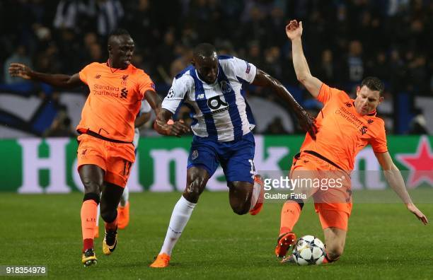 Porto forward Moussa Marega from Mali with Liverpool forward Sadio Mane from Senegal and Liverpool midfielder James Milner from England in action...