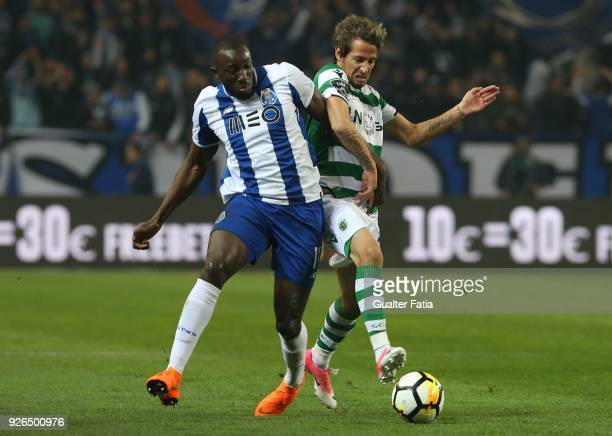 Porto forward Moussa Marega from Mali with Sporting CP defender Fabio Coentrao from Portugal in action during the Primeira Liga match between FC...