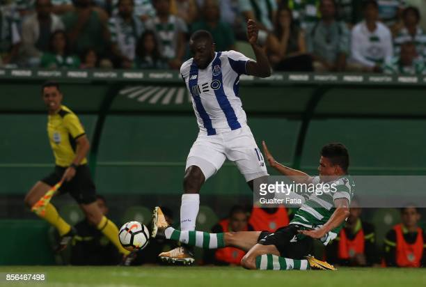 Porto forward Moussa Marega from Mali with Sporting CP defender Jonathan Silva from Argentina in action during the Primeira Liga match between...