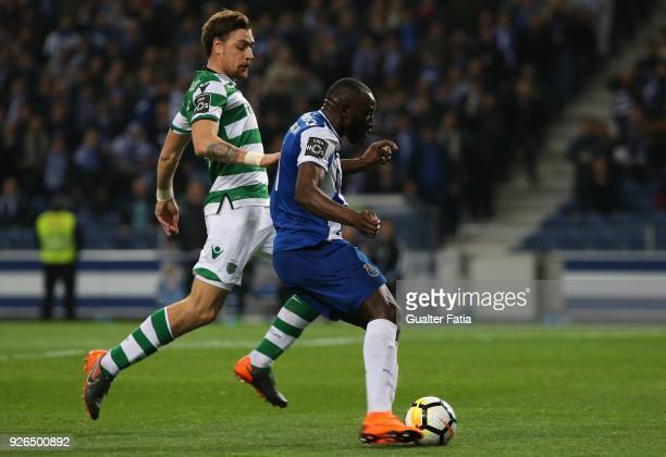 Porto forward Moussa Marega from Mali with Sporting CP defender Sebastian Coates from Uruguay in action during the Primeira Liga match between FC...