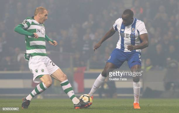 Porto forward Moussa Marega from Mali with Sporting CP defender Jeremy Mathieu from France in action during the Primeira Liga match between FC Porto...