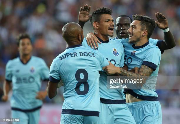 Porto forward Soares from Brazil celebrates with teammates after scoring a goal during the PreSeason Friendly match between Portimonense SC and FC...