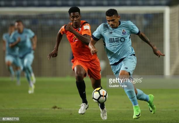 Porto forward Soares from Brazil with Portimonense SC defender Felipe Macedo from Brazil in action during the PreSeason Friendly match between...