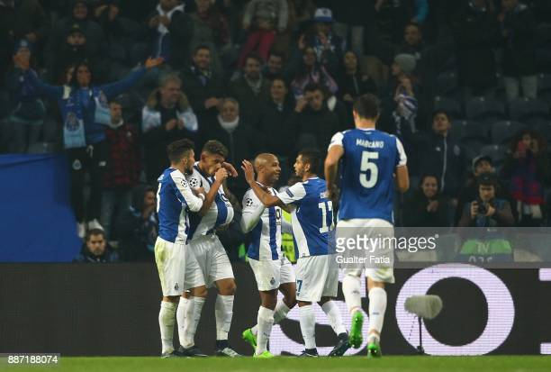 Porto forward Tiquinho Soares from Brazil celebrates with teammates after scoring a goal during the UEFA Champions League match between FC Porto and...