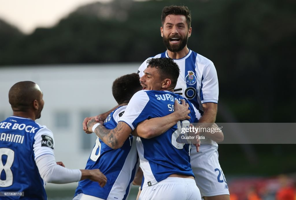 FC Porto forward Tiquinho Soares from Brazil celebrates with teammates after scoring a goalduring the Primeira Liga match between GD Estoril Praia and FC Porto at Estadio Antonio Coimbra da Mota on February 21, 2018 in Estoril, Portugal.