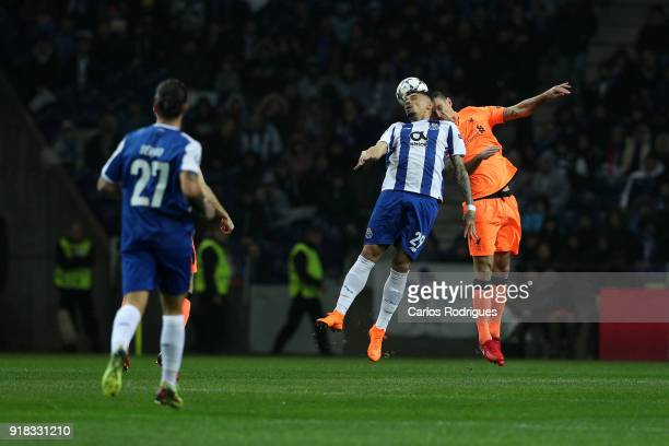 Porto forward Tiquinho Soares from Brazil vies with Liverpool defender Dejan Lovren from Croatia for the ball possessionduring the UEFA Champions...